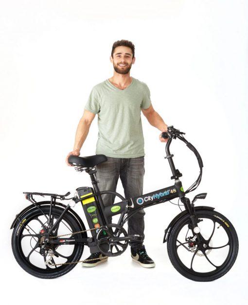 Man with 2018 City Hybrid All Black E-Bike