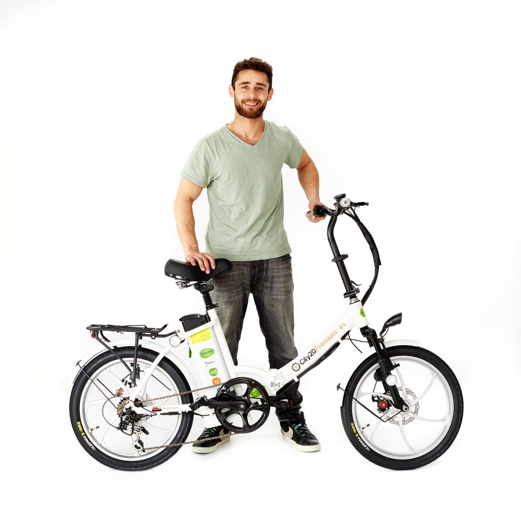 man with 2018 City Premium White and Silver Ebike